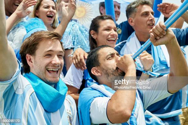 argentinian football fans watching football match - argentinas flagga bildbanksfoton och bilder