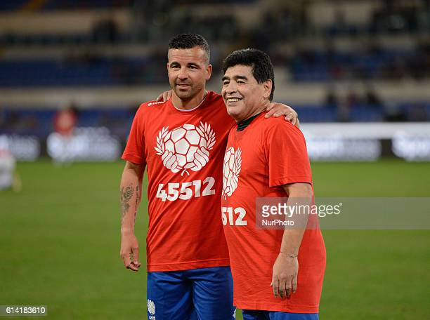 Argentinian football legend Diego Armando Maradona and Italy's Antonio Di Natale are pictured prior to compete in the 'Match of Peace United for...