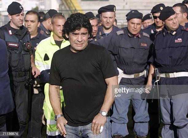 Argentinian football legend Diego Armando Maradona escorted by Italian policemen arrives at the Giugliano Stadium near Naples southern Italy 06 June...