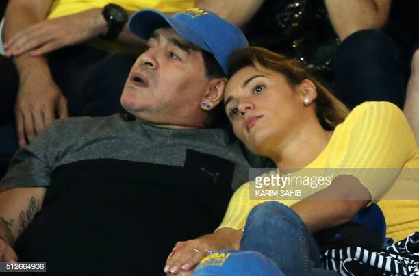 Argentinian football legend Diego Maradona attends with his girlfriend Rocio Oliva the ATP finals tennis match of the Dubai Duty Free Tennis...