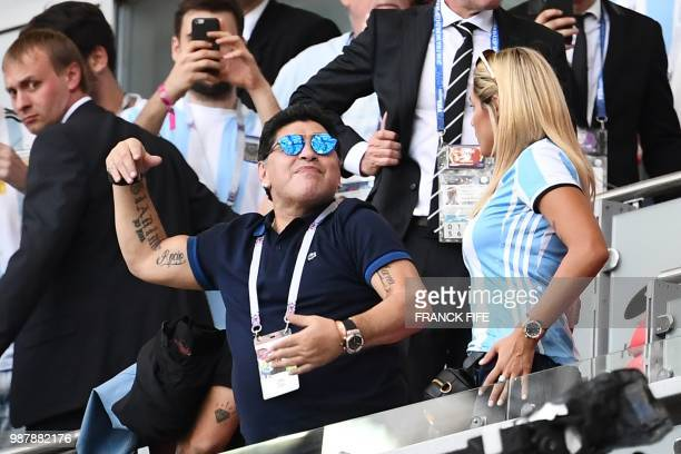 Argentinian football legend Diego Maradona celebrates after Argentina scored their first goal during the Russia 2018 World Cup round of 16 football...