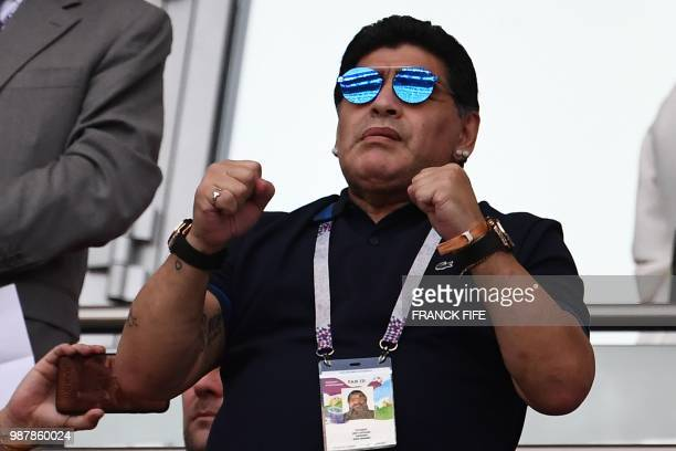 Argentinian football legend Diego Maradona gestures before the Russia 2018 World Cup round of 16 football match between France and Argentina at the...