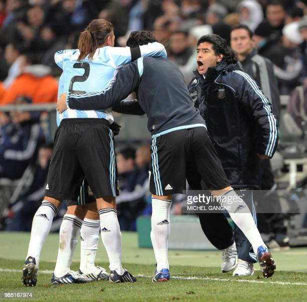 Argentinian football team's coach Diego Maradona celebrates with his players after they scored during the friendly football match France versus...