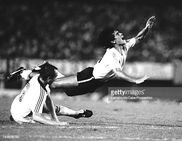 Argentinian footballer Diego Maradona in action for Argentina against West Germany Buenos Aires 24th March 1982 On the ground is German defender Uli...