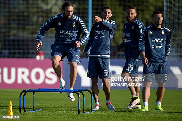 Argentinian footballers Gonzalo Higuain Angel Di Maria Nicolas Otamendi and Sergio Aguero take part in a training session in Ezeiza Buenos Aires on...