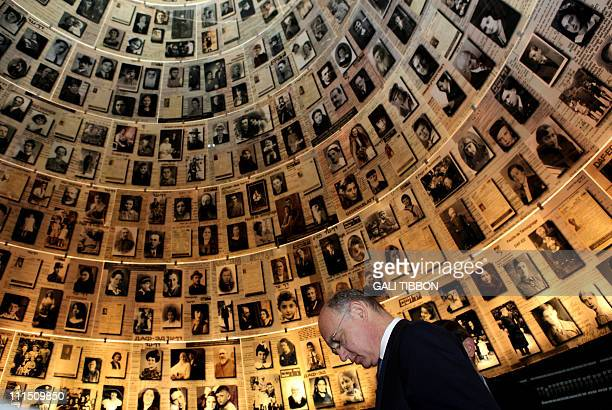 Argentinian Foreign Minister Hector Timerman looks at pictures of Jewish Holocaust victims in the Hall of Names during a visit to the Yad Vashem...