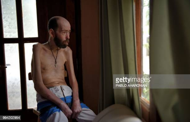 Argentinian former farmworker Fabian Tomasi looks through the window during an interview with AFP at his home in Basavilbaso Entre Rios province...