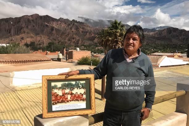 Argentinian former footballer of Pueblo Nuevo David Gordillo poses with a picture displaying him among his Pueblo Nuevo teammates and Argentina's...