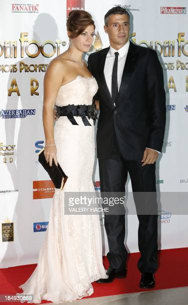 Argentinian former international football player Hernan Crespo poses with his wife Alessia Rossi on October 16 2013 in Monaco for the 2013 Golden...