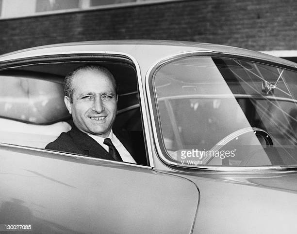 Argentinian former racing driver Juan Manuel Fangio in his car at London Airport on his arrival from Milan 24th April 1959 He is in Britain to act as...