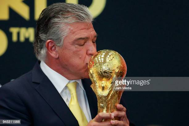 Argentinian former soccer player Hector Miguel Zelada kisses the FIFA Trophy during the FIFA Trophy Tour at Residencia Oficial de Los Pinos on April...
