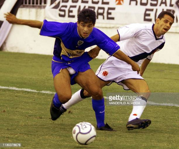 Argentinian forward Burdisso of the team Boca Junior fights for the ball with Pedrinho of Vasco de Gama in a qualifying match for the quarterfinals...