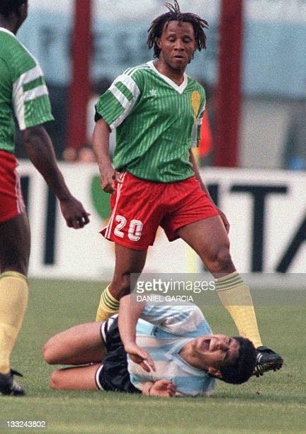 Argentinian forward Diego Maradona grimaces in pain after being fouled by Cameroon's midfielder Cyrille Makanaky during the World Cup opening soccer...