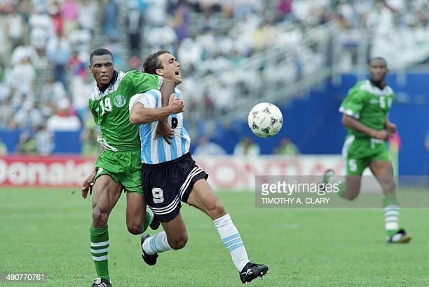 Argentinian forward Gabriel Batistuta is blocked by Nigerian Michael Emenalo on June 25 1994 at Foxboro stadium in Boston during their World Cup...