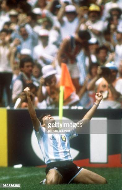 Argentinian forward Jorge Burruchaga is on his knees to celebrate the goal he just scored to give his team a 32 lead over Germany This would turn out...