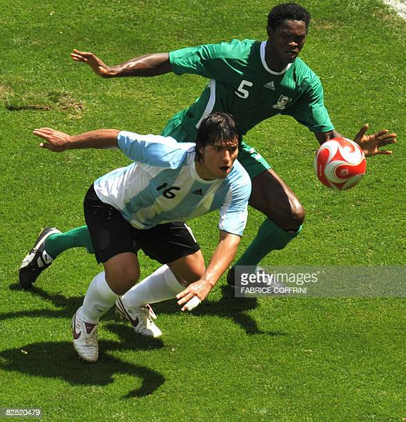 Argentinian forward Sergio Aguero vies with Nigerian defender Dele Adeleye during the men's Olympic football final at the national stadium in Beijing...