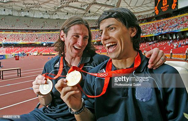 Argentinian forwards Lionel Messi and Sergio Aguero pose with their gold medals during the men's Olympic football tournament medal ceremony at the...