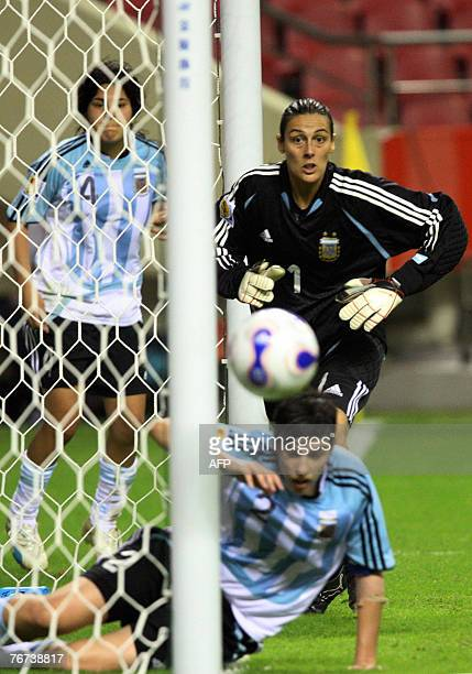 Argentinian goalie Romina Ferro watches with teammate Gabriela Chavez a shot from the Japanese team goes wide during their 2007 FIFA Women's World...