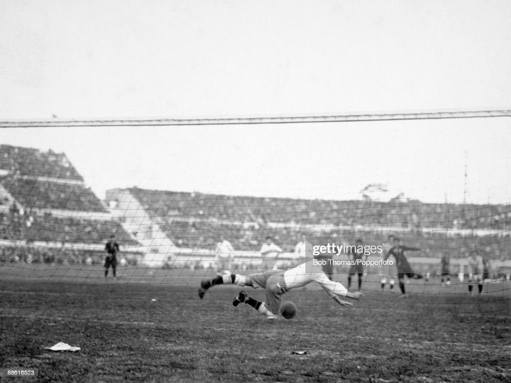 Argentinian goalkeeper Angel Bossio is beaten by a penalty kick taken by Mexico's Hilario Lopez during the FIFA World Cup match at the Estadio Centenario in Montevideo, 19th July 1930. Argentina won 6-3.
