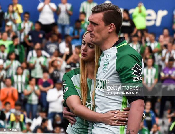 Argentinian goalkeeper Franco Armani and his wife Paola Rendon are pictured during his farewell from Colombia's Atletico Nacional at the Atanasio...