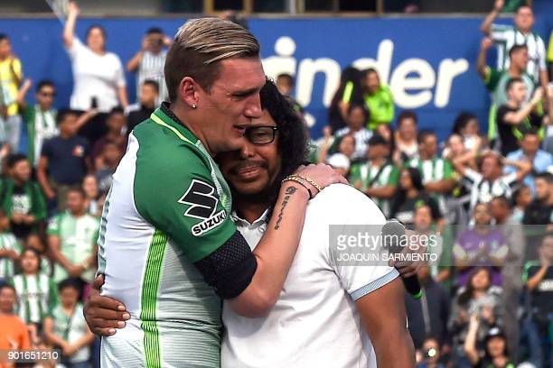 Argentinian goalkeeper Franco Armani hugs Colombian former goalkeeper Rene Higuita during his farewell from Colombia's Atletico Nacional at the...