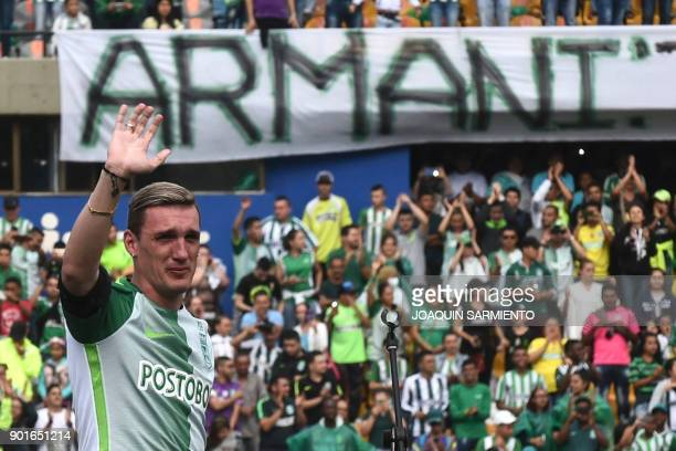 Argentinian goalkeeper Franco Armani waves to supporters during his farewell from Colombia's Atletico Nacional at the Atanasio Girardot Stadium in...