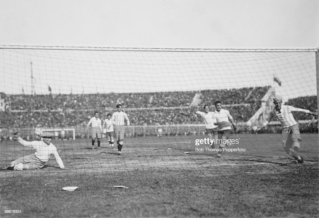 Argentinian goalkeeper Juan Botasso (left) is beaten, and defender Juan Evaristo (right) can't clear the ball off the line as Pablo Dorado's (not in picture) shot gives Uruguay an early lead in the FIFA World Cup Final at the Estadio Centenario in Montevideo, 30th July 1930. Uruguay defeated Argentina 4-2 to win the Jules Rimet Trophy.