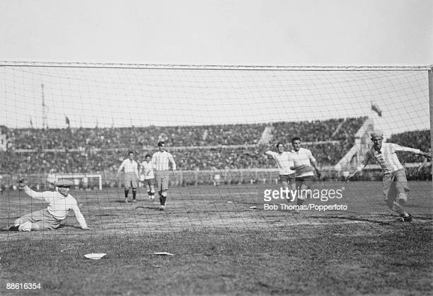 Argentinian goalkeeper Juan Botasso is beaten and defender Juan Evaristo can't clear the ball off the line as Pablo Dorado's shot gives Uruguay an...