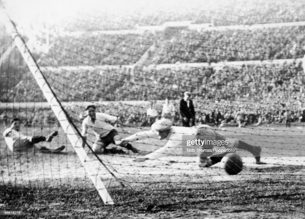 Argentinian goalkeeper Juan Botasso is beaten by Pedro Cea's (centre) shot for Uruguay's 2nd goal during the FIFA World Cup Final between Uruguay and Argentina at the Estadio Centenario in Montevideo, 30th July 1930. Uruguay won 4-2.