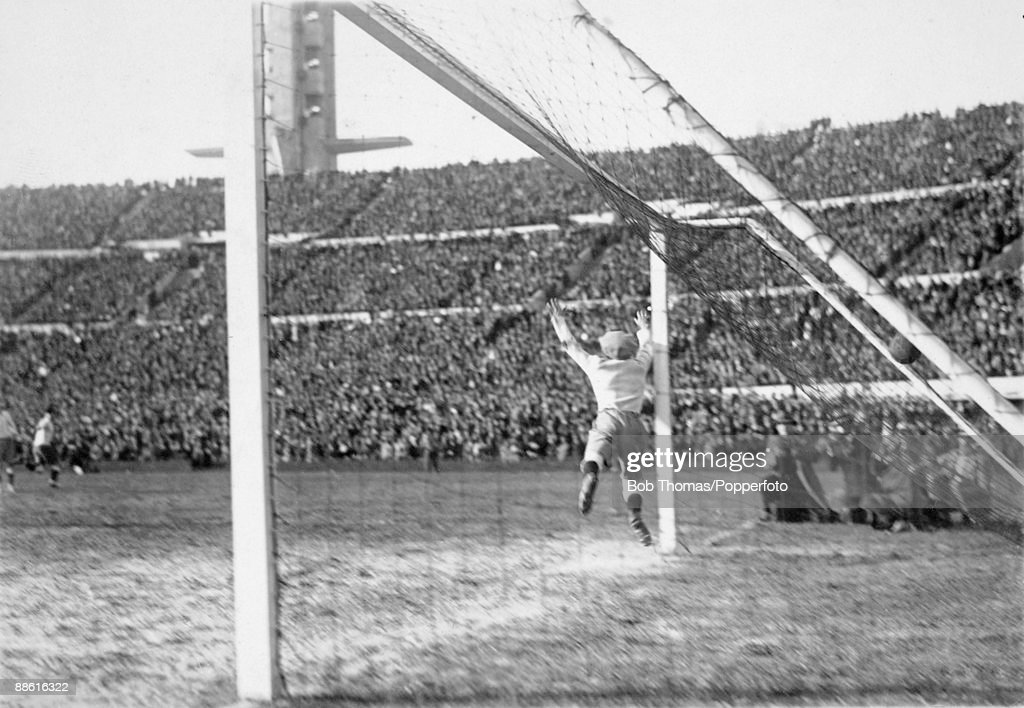 Argentinian goalkeeper Juan Botasso is beaten by Santos Iriarte (not in picture) for Uruguay's 3rd goal during the FIFA World Cup Final at the Estadio Centenario in Montevideo, 30th July 1930. Uruguay won 4-2. (Photo by Bob Thomas/Popperfoto/Getty Images).