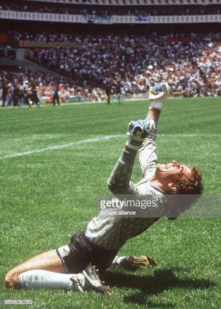 Argentinian goalkeeper Nery Pumpido kneels on the pitch and with a thankful gestures towards heaven On the way to winning the title the Argentinian...