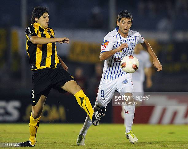 Argentinian Godoy Cruz's player Alvaro Navarro vies for the ball with Emilio Mac Eachen of Uruguay's Penarol during their Libertadores Cup football...
