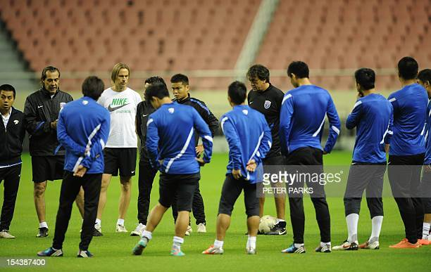 Argentinian head coach Sergio Batista talks to his Shanghai Shenhua before a training session at Hongkou stadium in Shanghai on October 19 2012...