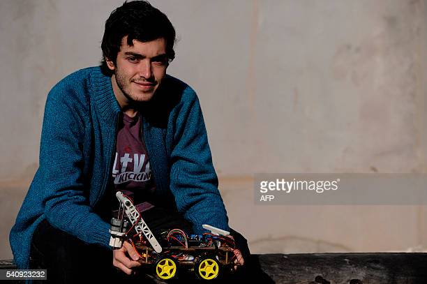 Argentinian industrial engeneering student of the National University of Cuyo Marcos Bruno poses with a robot made by him in Mendoza Argentina on...
