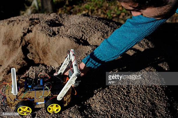 Argentinian industrial engeneering student of the National University of Cuyo Marcos Bruno shows a robot made by him in Mendoza Argentina on June 17...