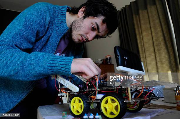 Argentinian industrial engeneering student of the National University of Cuyo Marcos Bruno works on a robot made by him in Mendoza Argentina on June...