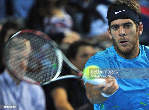 Argentinian Juan Martin Del Potro returns the ball to French Jo-Wilfried Tsonga during the ATP Open 13 tennis tournament semi final match, on...