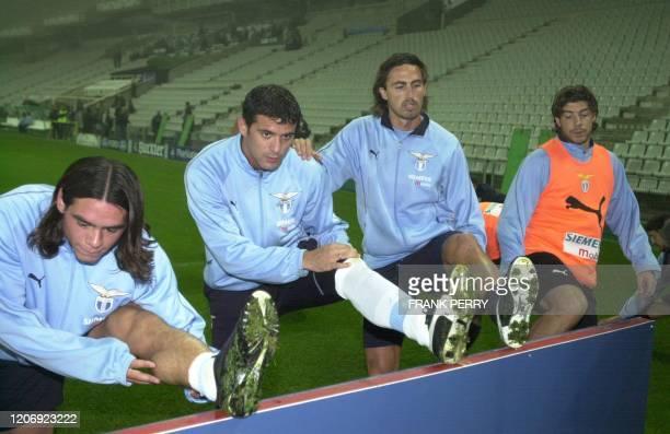 Argentinian Lucas Castroman Yugoslav Dejan Stankovic Italians Dino Baggio and Giuliano Giannichedda of Lazio Rome stretch during a training session...