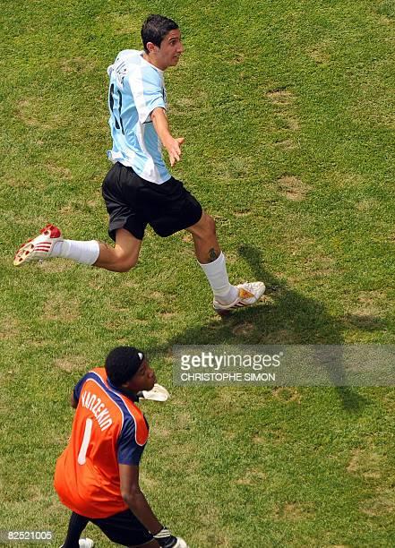Argentinian midfielder Angel Di Maria celebrates past Nigerian goalkeeper Ambruse Vanzekin after scoring the opening goal in the men's Olympic...