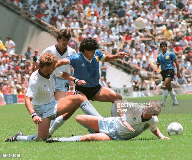 Argentinian midfielder Diego Maradona dribbles past three English defenders 22 June 1986 in Mexico City during the World Cup quarterfinal soccer...