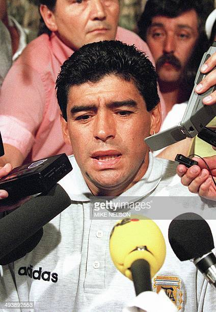 Argentinian midfielder Diego Maradona is surrounded by journalists 30 June 1994 in Dallas after learning that he tested positive in a drug test...