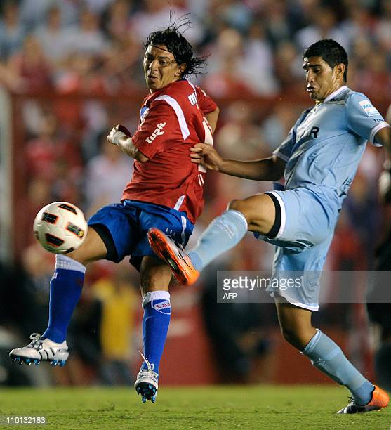 Argentinian midfielder Marcelo Gallardo of Uruguay's Nacional vies for the ball with Argentinos Junior' midfielder Matias Laba during their Copa...
