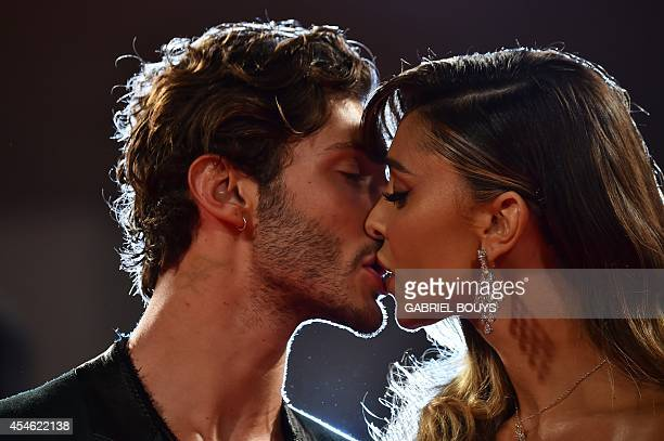 Argentinian model Belen Rodriguez and Stefano De Martino kiss as they arrive for the screening of the movie Pasolini presented in competition at the...
