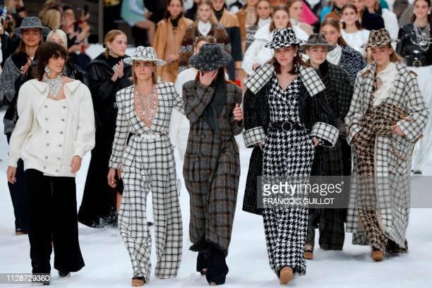 Argentinian model Mica Arganaraz British model and actress Cara Delevingne Italian model Mariacarla Boscono and Australian model Cat McNeil react and...