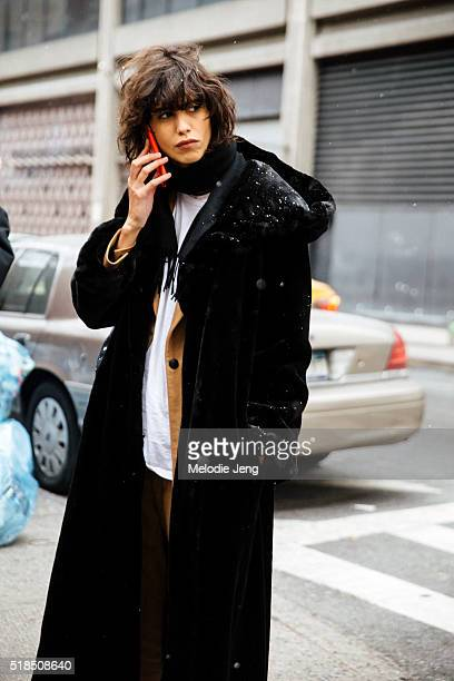 Argentinian model Mica Arganaraz makes a phone call after the Tommy Hilfiger show at Park Avenue Armory during New York Fashion Week Women's...