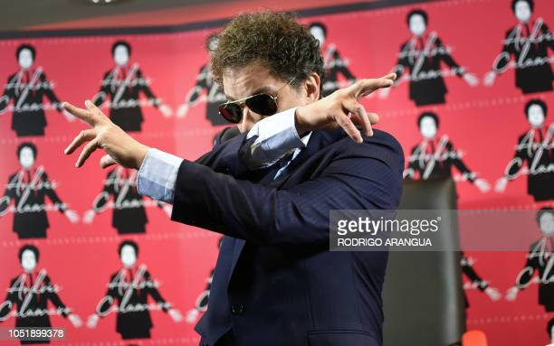 Argentinian musician Andres Calamaro poses for the press during the release of his Album 'Cargar la Suerte' in Mexico City on October 11 2018