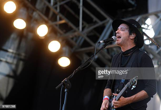 Argentinian musician Gustavo Cerati performs during the Argentina embraces Chile solidarity concert in Palermo park Buenos Aires on March 13 2010 The...