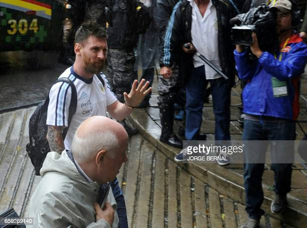 Argentinian national football team player Lionel Messi waves as he arrives at the Hernando Siles stadium ahead of Argentina's 2018 FIFA World Cup...