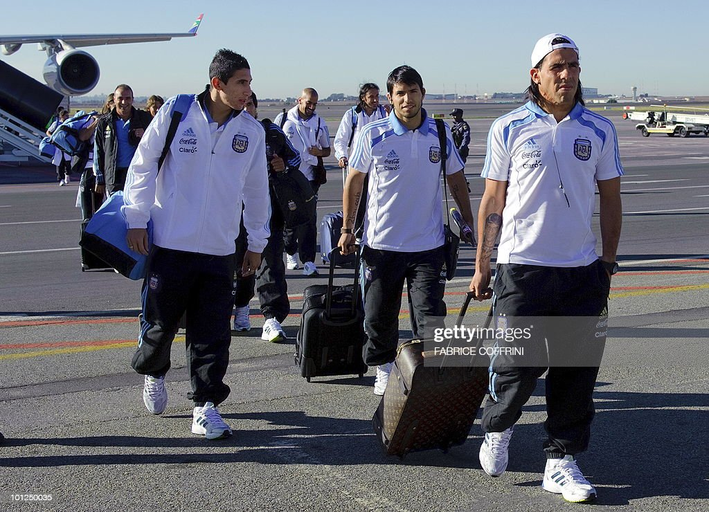 Argentinian national football team players (L to R) Angel Di Maria, Sergio Aguero and Carlos Tevez leave their plane upon their team's arrival at O. R. Tambo international airport on May 29, 2010 in Johannesburg ahead of the 2010 FIFA World Cup in South Africa. Argentina will play their first match against Nigeria on June 12.