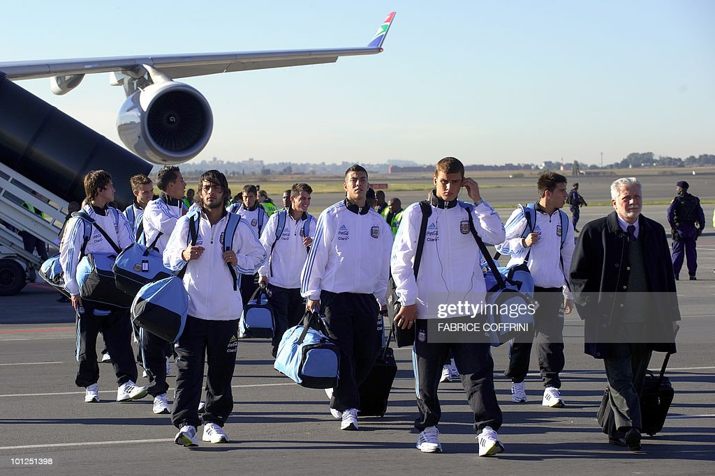 Argentinian national football team players leave their plane upon their arrival at O. R. Tambo international airport on May 29, 2010 in Johannesburg ahead of the 2010 FIFA World Cup in South Africa. Argentina will play their first match against Nigeria on June 12.